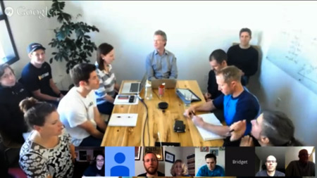 A typical TeamSnap company meeting includes live and remote participants. Dancing not pictured.