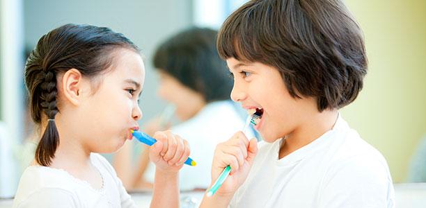 two-girls-brushing-teeth