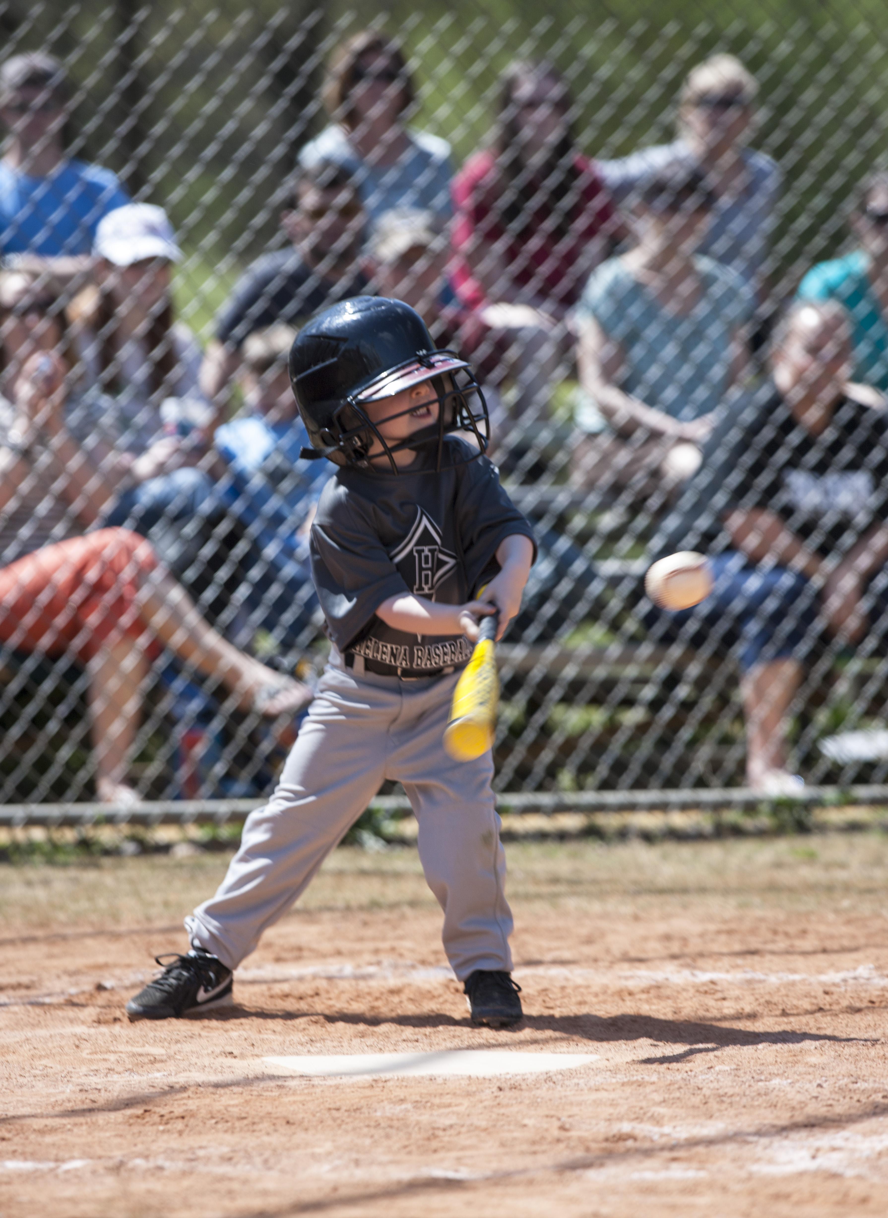Little Kid Playing Baseball